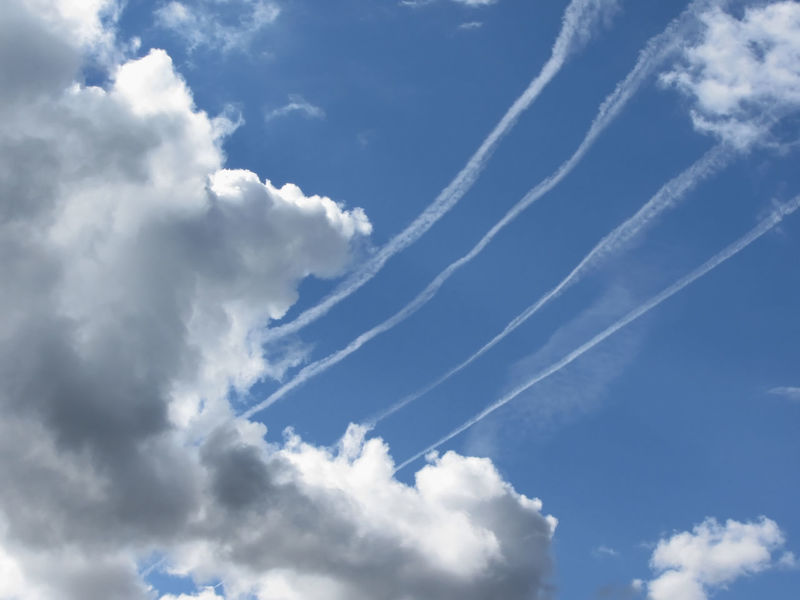 Contrails of aircraft and giants cumulonimbus clouds in the blue sky Aviation Azure Blue Cloud Cloudscape Contrails Covered Cumuli Cumulonimbus Cumulus Cloud Day Fluffy Giant Clouds Mid-air Moisture Nimbi Panoramic Precipitation Sky Sunlight Sunny Trails Tranquil Scene Weather White