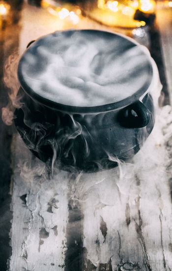 Series of spooky Halloween themed images, good for backgrounds or advertisements. Halloween Holiday Smoke Background Cauldron Copyspace Eerie Fog Halloween Background Halloween Time Magic Potion Spooky