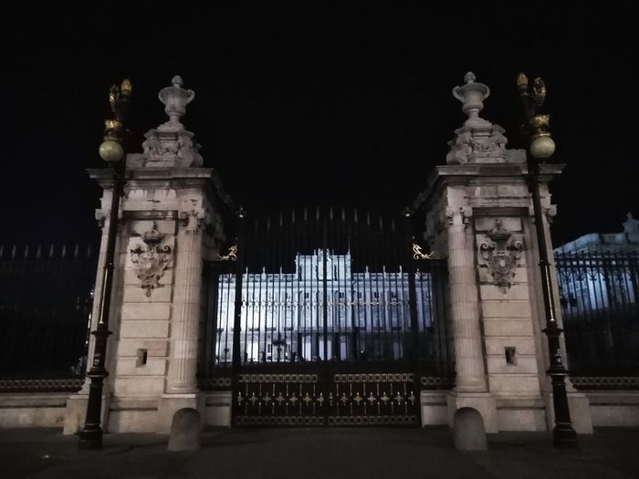 Night view of the royal palace gate and the palace facade beyond it. Royal Residence Madrid, Spain Travel Photography Travel Destination Tourism Black Sky Monarchy Night Night Photography Huawei Photography Closed Gate Royal Palace Light And Shadow Darkness Dark Night Politics And Government Architectural Column History Architecture Building Exterior Gate Palace Royalty Entrance Entryway HUAWEI Photo Award: After Dark