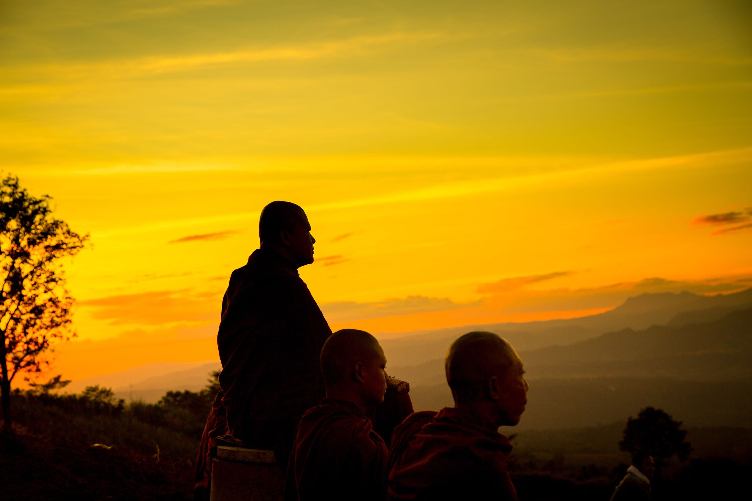 sunset, togetherness, orange color, real people, sky, nature, love, silhouette, leisure activity, three people, beauty in nature, lifestyles, bonding, men, outdoors, scenics, friendship, tranquility, women, people