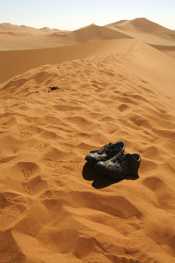 Ops! Scarpe dimenticate nel deserto ;-) Namib Desert Namibia Landscape NamibiaPhotography Shoes ♥ Travel Travel Photography Traveling Arid Climate Beauty In Nature Desert Environment Extreme Terrain Land Landscape No People Non-urban Scene Sand Sand Dune Scenics - Nature Shoes Shoes In The Sand Tranquil Scene Tranquility Travelphotography Wildlife