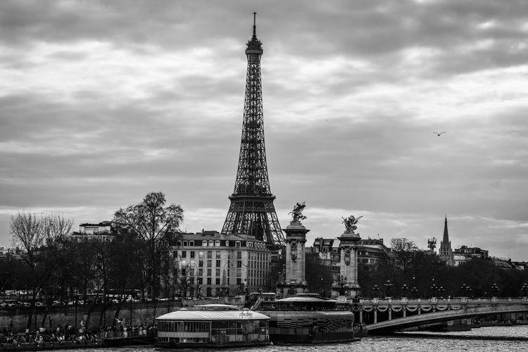 Eiffel Tower Paris, France  Tour Eiffel Architecture Building Building Exterior Built Structure City Cloud - Sky Day Eiffelturm History Nature No People Outdoors Sky Spire  Tall - High The Past Tourism Tower Travel Travel Destinations Water The Traveler - 2018 EyeEm Awards