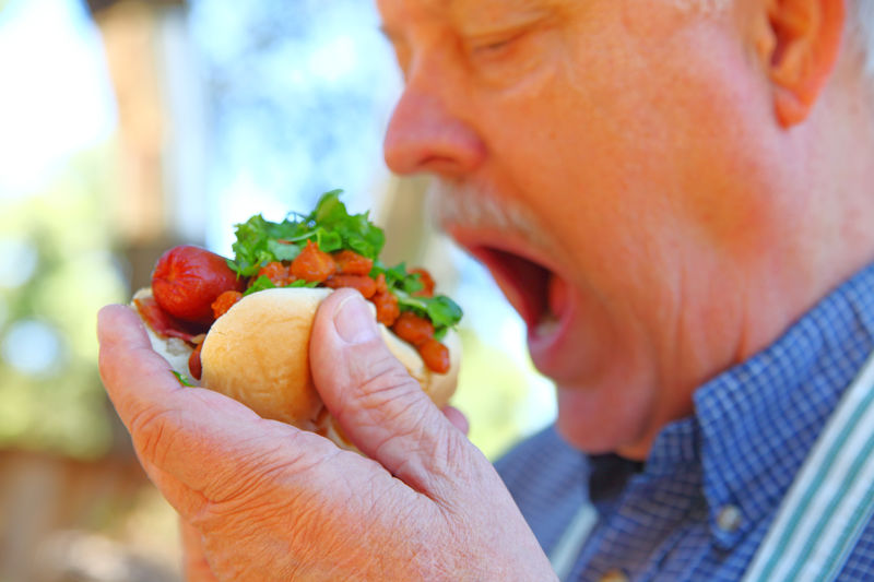 Close-Up Of Man Eating Sandwich