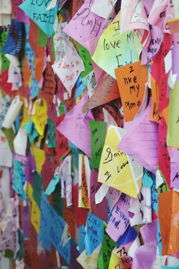 Full frame shot of adhesive notes on bulletin board during kala ghoda festival