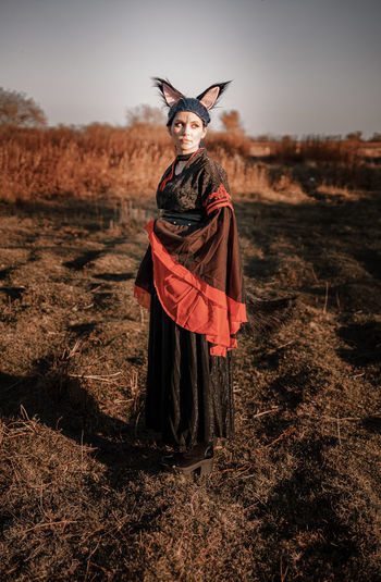 Full length of woman wearing costume standing on field