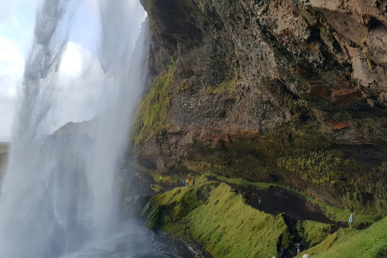 Scenic view of seljalandsfoss by mountains