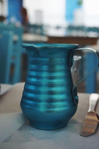 a mug of Retsina Cold Drink Wine Mug Blue Retsina Greek Drink Blue Color Taverna Table Restaurant Heat - Temperature Close-up Food And Drink Beverage