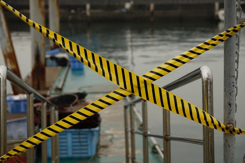Cordon Tapes At Harbor In City