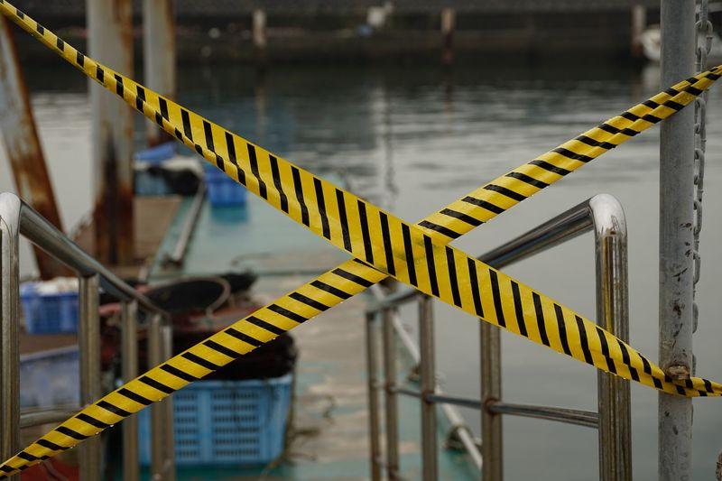 Cordon tapes at harbor in city