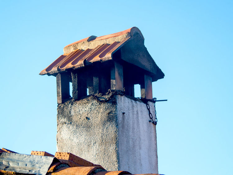 Ancient Ancient Architecture Architecture Architecture Blue Building Building Exterior Built Structure Chimney Chimneys Clear Sky Construction Day Low Angle View Nature No People Outdoors Perching Roof Rural Architecture Rural House Rural Life Sky Vintage