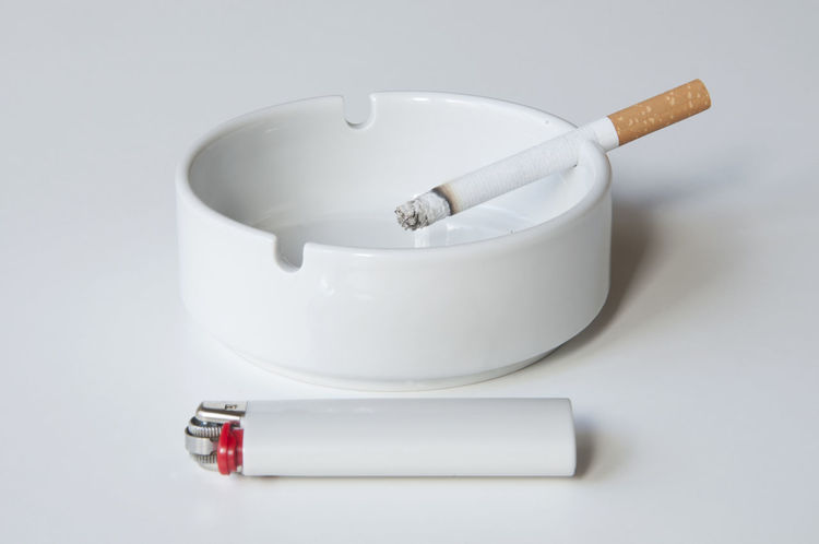 cigarette, ashtray and lighter on white table Ashtray  Cigarette  Close-up Day Desk Filter Geometry Indoors  Lighter Minimalism Neutral No People Round Single Smoking Smoking Issues Studio Shot Table White White Background