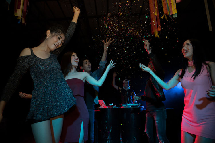 Arms Raised Body Part Celebration Dancing Emotion Enjoyment Event Friendship Fun Group Of People Happiness Human Arm Human Limb Limb Night Nightclub Nightlife Party - Social Event Real People Three Quarter Length Young Adult Young Women