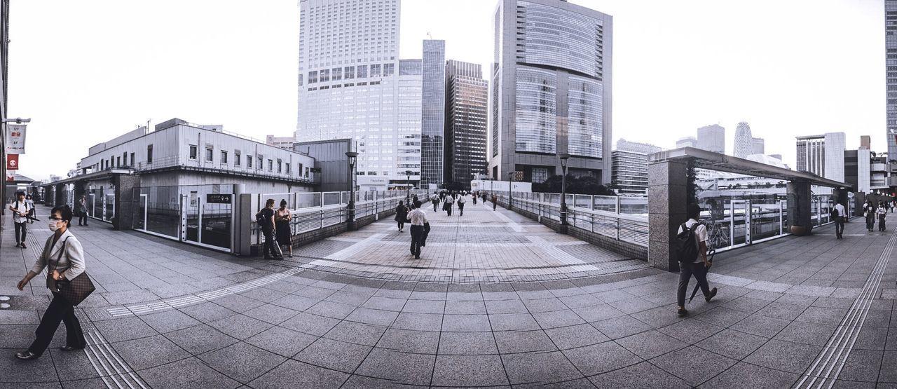 PEOPLE ON STREET BY BUILDINGS IN CITY