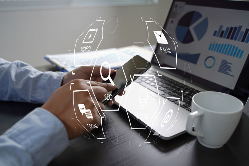 Communication One Person Text Human Hand Human Body Part Cup Western Script Real People Hand Wireless Technology Coffee Coffee Cup Technology Coffee - Drink Mug Connection Mobile Phone Table Men