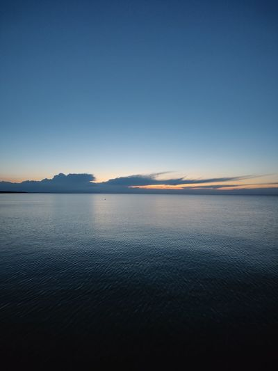 Scenic view of sea against beautiful sky during sunset