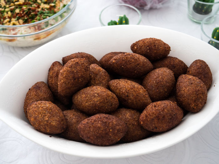 A plate with kibbe, a famous arabic food from Lebanon Kibbe Arabic Arabic Food Bowl Brown Close-up Crockery Focus On Foreground Food Food And Drink Freshness Fried Healthy Eating Indulgence Kobbe Meal Meat Mutabbal No People Plate Ready-to-eat Snack Still Life Table Temptation