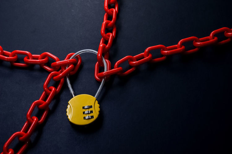 Red chain and yellow padlock with number combination on blackboard. City Black Background Chain Close-up Conceptual Photography  Day Hanging Internet Lock Metal No People Operation Outdoors Red Safety Security