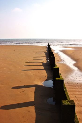 Sand shadows #1 EyeEm Selects EyeEm Best Shots Dymchurch Beach Kent Breakwater Sea Defences Beach Sea Sand Nature Sunlight Scenics Water Horizon Over Water Beauty In Nature Shadow Tranquility Tranquil Scene Day Outdoors No People Sky Wave Clear Sky