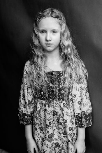 Young girl with curly hair in hippie style Black & White Boho Chic Freedom Portrait Of A Woman Beautiful Woman Black Background Blackandwhite Boho Curly Hair Front View Hair Hairstyle Hippie Hippielife Indoors  Long Hair Looking At Camera One Person Portrait Portrait Photography Smiling Women