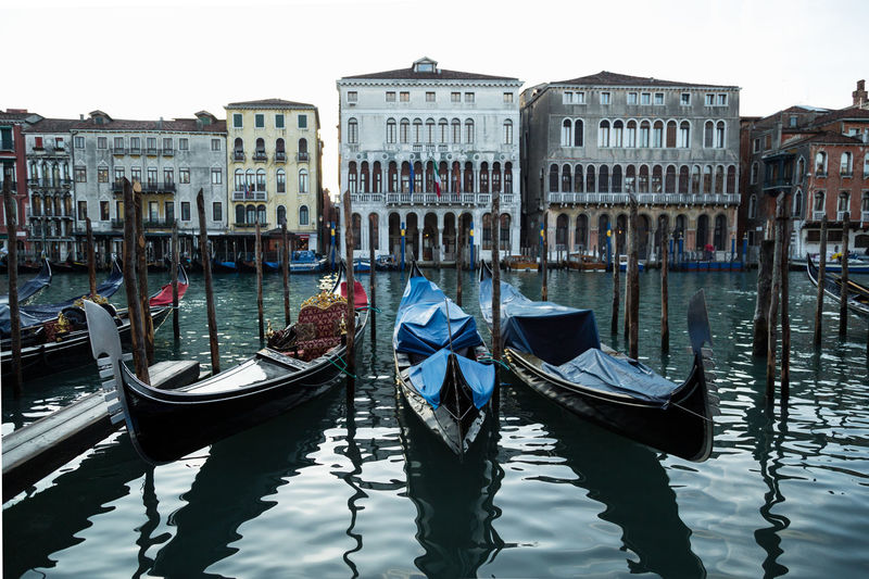 Gondolas moored on grand canal in city
