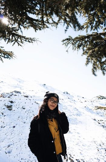 Ele One Person Real People Winter Snow Lifestyles Standing Cold Temperature Young Adult Leisure Activity Front View Young Women Looking At Camera Warm Clothing Clothing Nature Sky Beauty In Nature Portrait Day Outdoors