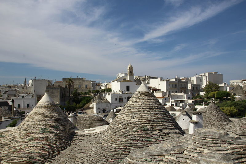 Trulli houses view Puglia Ancient Civilization Architecture Building Exterior Built Structure City Cityscape Cloud - Sky Day History Italian Tradition Italy No People Outdoors Sky Travel Destinations Trulli Trulli Houses Trullilovers