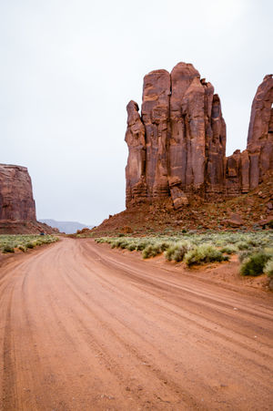 Arid Climate Day Desert Eroded Extreme Terrain Fossil Geology Landscape Monument Valley Tribal Park Nature No People Outdoors Road Rock - Object Rock Formation Sand Sand Dune Sandstone Sky