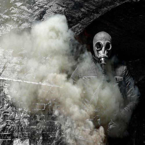 Man wearing gas mask in tunnel