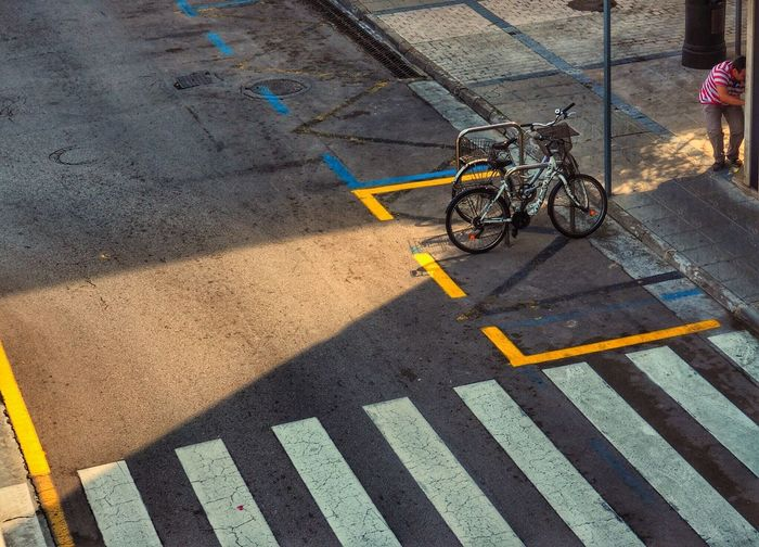 Sunlight High Angle View One Person Bicycle City Urbanphotography Urban Geometry Lightandshadow Pattern Urban Photography SPAIN Zebra Crossing