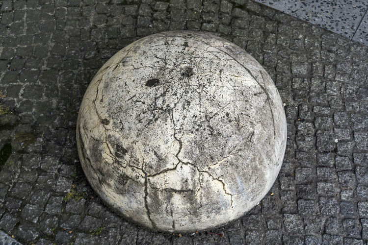 Berlin, Germany, August 29, 2018: Close-Up of Old Hemispherical Bollard as Street Marker Berlin Boundary Cobblestone Streets Germany 🇩🇪 Deutschland Horizontal Random Shape Street Marker Bollard Close-up Cobblestone Color Image Concrete Day Dilapidated Gray Hemisphere Irregular No People Old Outdoors Pattern Semi-sphere Shapes And Forms Stone Material