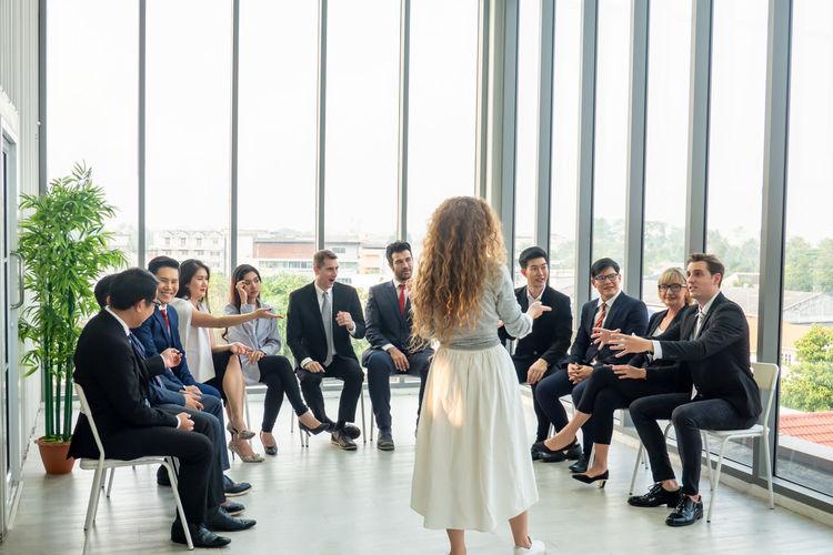 Group of people sitting in corridor