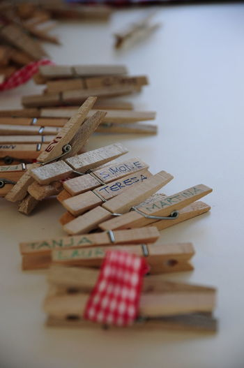 Text On Wooden Clothespins Over Table
