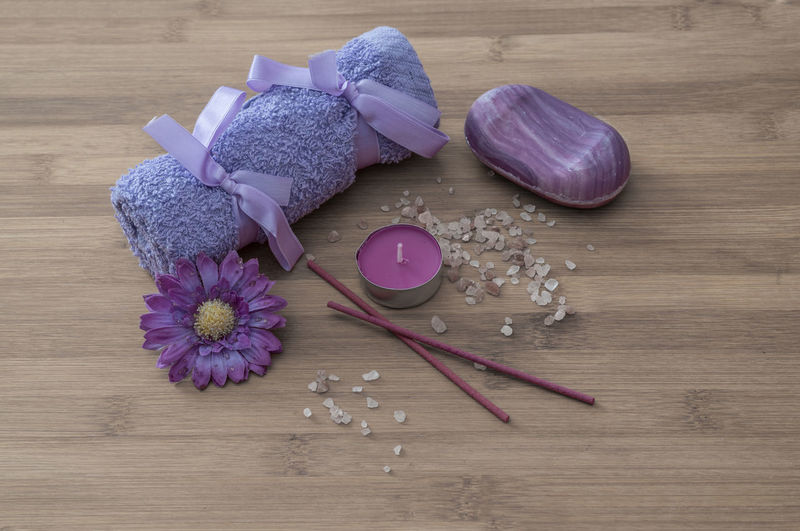 High angle view of spa treatment items on wooden table