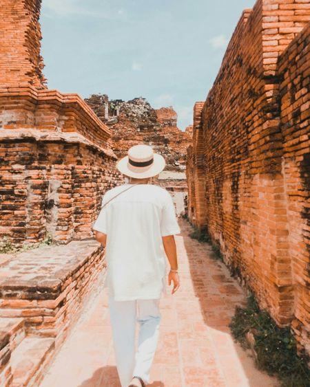 Rear view of man walking at old ruins