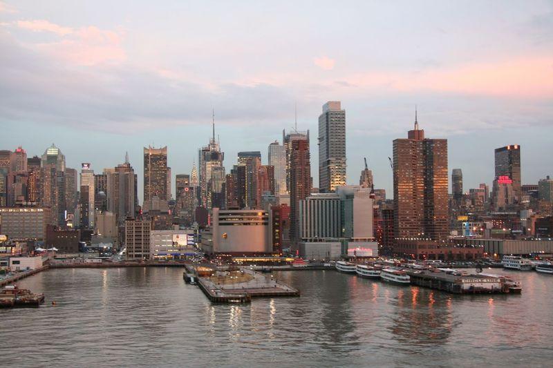 Harbor At Midtown Manhattan Against Sky