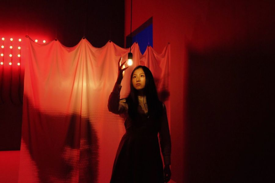 One Person Young Adult Young Women Standing Real People Women Red Curtain Indoors  Lifestyles Illuminated Wall - Building Feature Front View Leisure Activity Adult Three Quarter Length Lighting Equipment Fashion Arms Raised Human Arm EyeEmNewHere The Week on EyeEm Red Red Color Red Light