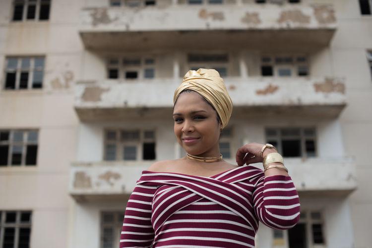Portrait of woman standing against buildings