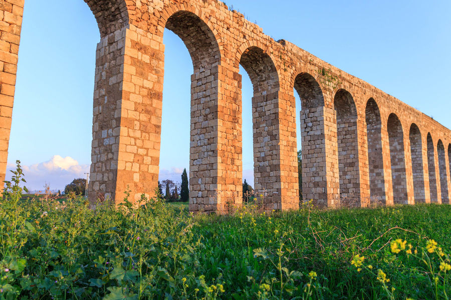 Remains of an ancient Roman aqueduct between Acre and Nahariya in Israel Ancient Antique Aquatic Aqueduc Aqueduct Liquid Nahariya Remains Travel Acre Between History Israel Old Roman Ruin Stone Tourism Water