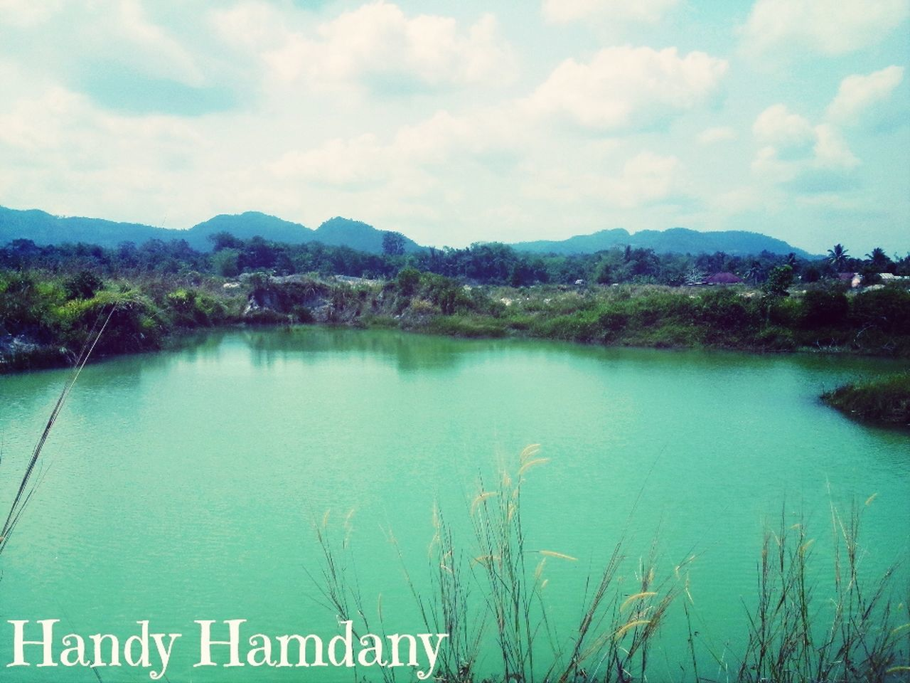 water, lake, day, outdoors, tranquility, scenics, tranquil scene, nature, no people, grass, landscape, beauty in nature, sky, tree