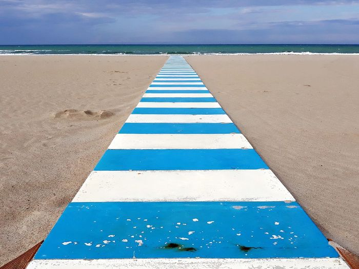 Water Sea Beach Blue Sand Sky Horizon Over Water Cloud - Sky vanishing point Coast Pastel Colored Passageway The Mobile Photographer - 2019 EyeEm Awards The Architect - 2019 EyeEm Awards