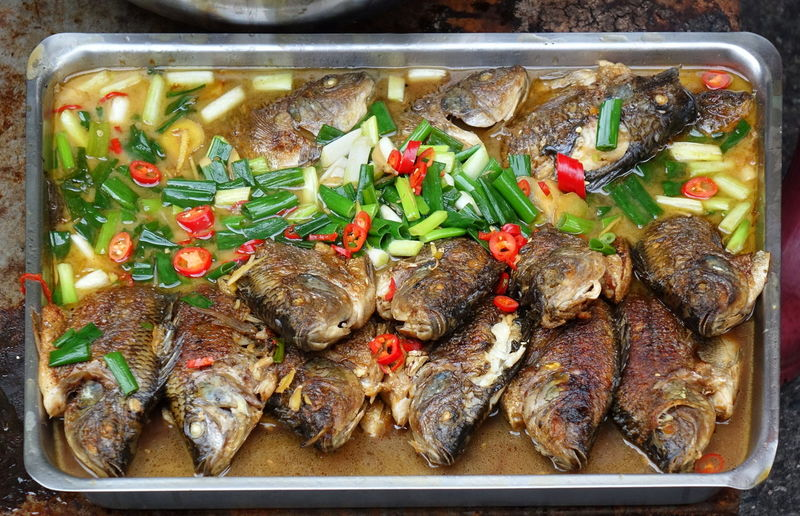 Fried Tilapia fish with chilies and scallions Chinese Food Taiwan Food Tilapia Fish Chili  Fish Food Freshness Fried Fish Healthy Eating High Angle View Ready-to-eat Red Chilies Scallion Seafood Tray