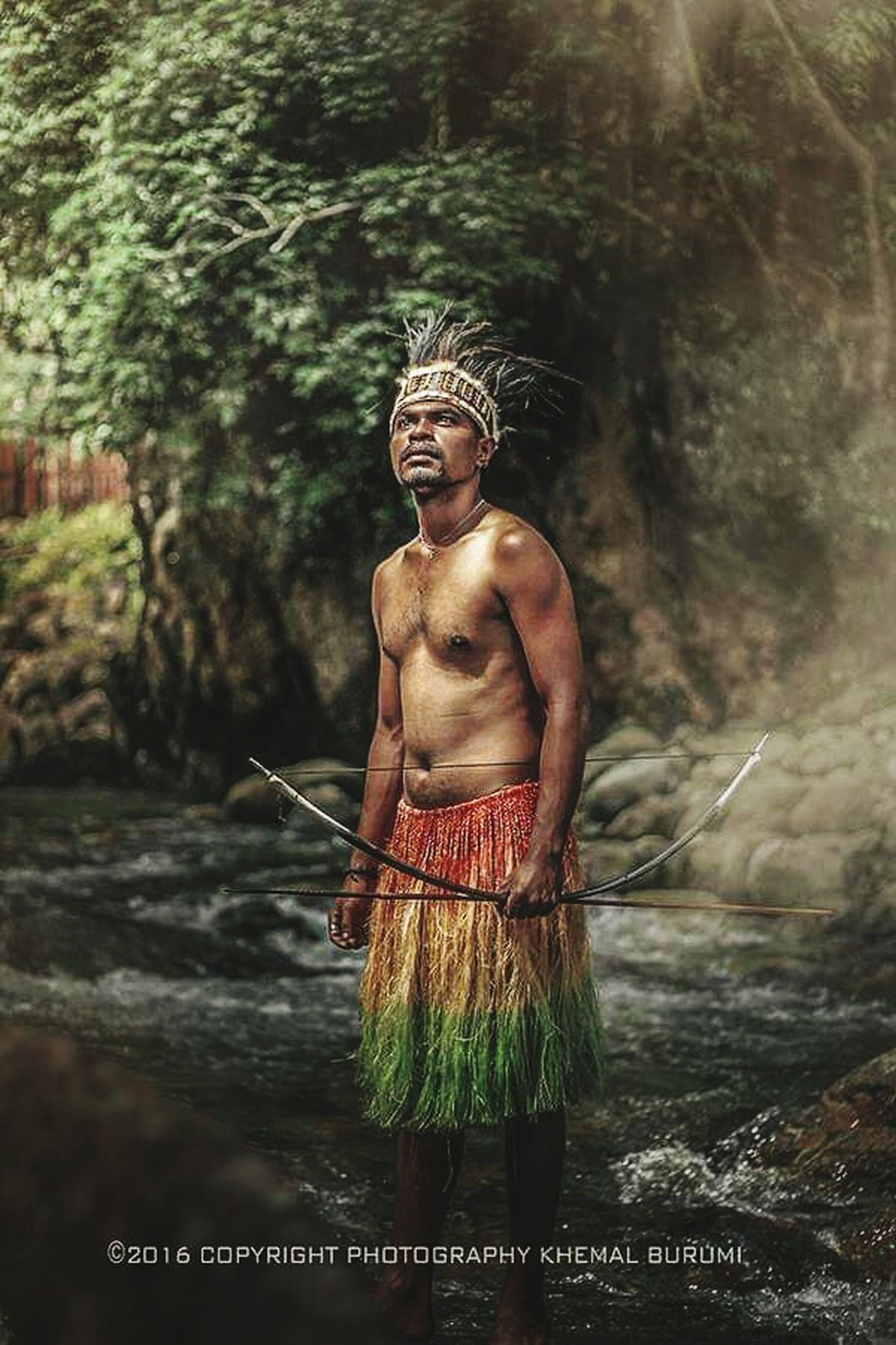 plant, nature, people, shirtless, tree, land, three quarter length, real people, front view, men, standing, outdoors, day, holding, focus on foreground, adult, crown