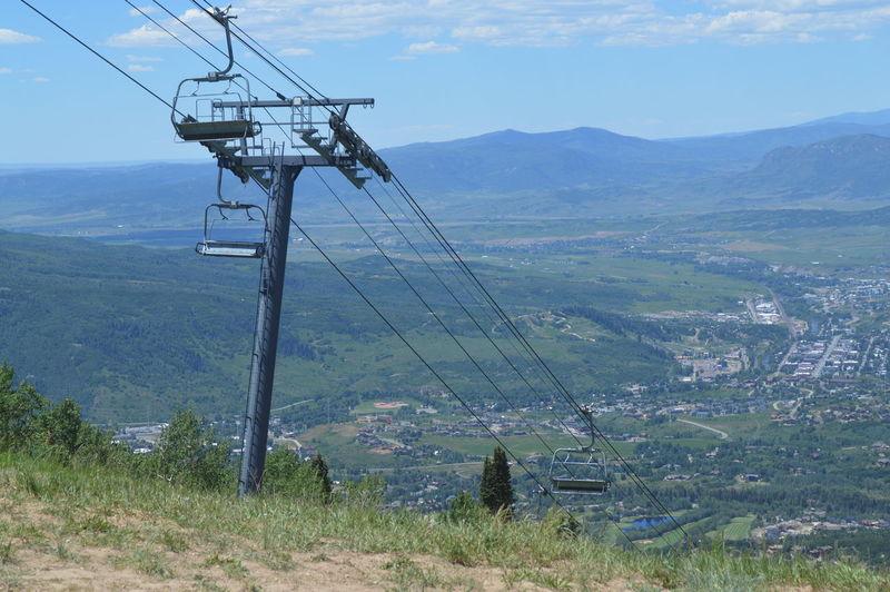 Ski Lifts Against Landscape