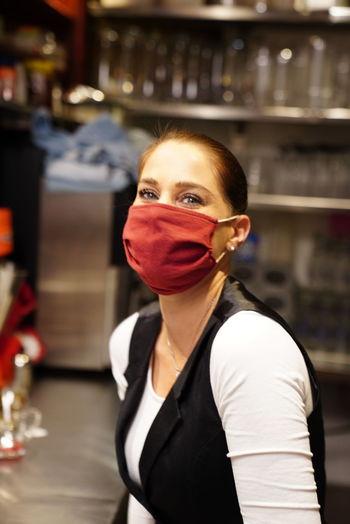 Portrait of woman standing in restaurant