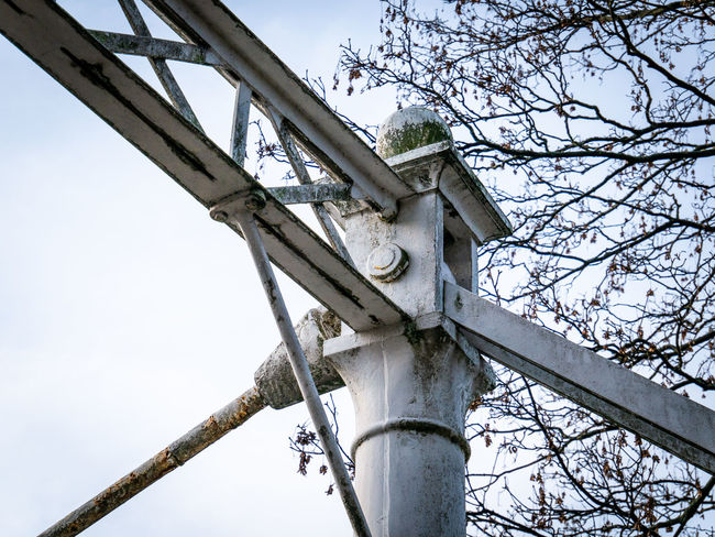 Low Angle View Sky Day Outdoors Metal Bridge Antwerpen Belgium Park Antwerpen Stadspar Stadspark Focus On Foreground Metal - Material Clear Sky Architecture Architecture Tree Nature No People Machinery Old
