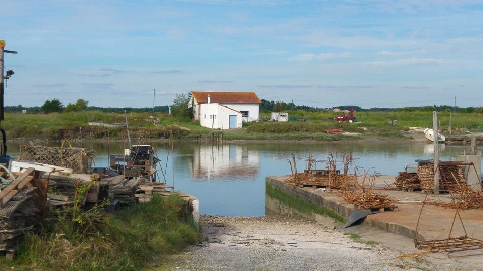 Charentemaritime Water Beach Outdoors Building Exterior No People Day Sea Nature Landscape Architecture Tree Sky Charente-Maritime Francetourisme Vacations France Photos Harbor Cabane De Pecheur Nature Architecture Reflection Ostréiculture Habor Seals