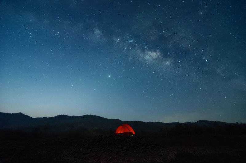 Scenic view of mountains against sky at night