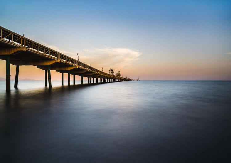 Coastal industrial pier for oil transport near cagliari, sardinia