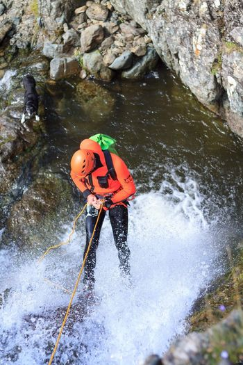 Cumbrian Canyoning Waterfalls Wetsuit Needed Abseilling Canyoning EyeEm Selects Water Day Nature High Angle View Waterfront Outdoors One Person Lifestyles Activity Sport Safety Adventure