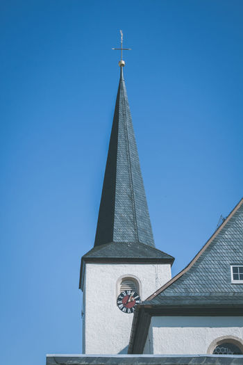 Kirche in Posseck Church Kirche Posseck Architecture Bell Tower Blue Building Exterior Built Structure Churches Clear Sky Clock Clock Tower Cross Day Low Angle View No People Outdoors Place Of Worship Religion Sky Spirituality